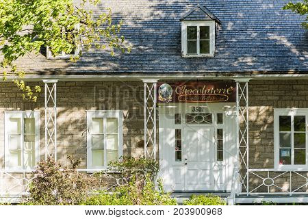 Ile D'Orleans Canada - June 1 2017: Chocolaterie sign and building store entrance in St-Francois