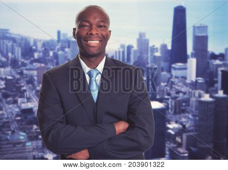 Successful african american businessman with skyline with skyline of city in background