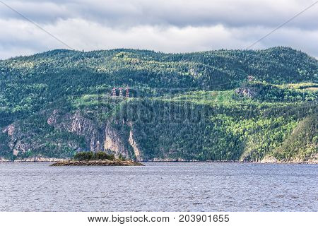 Fjord Cliff Coast In Saguenay River Closeup Of Cliffs With Power Lines, Wires And Towers, Tree Fores