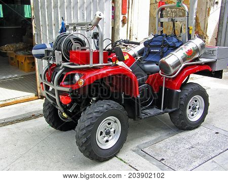 Tai O, Hong Kong - March 24, 2003: A quad that has been specifically upgraded for the narrow streets of Tai O to a fire engine.