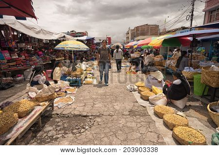 May 6 2017 Otavalo Ecuador: indigenous produce vendors in the Saturday market
