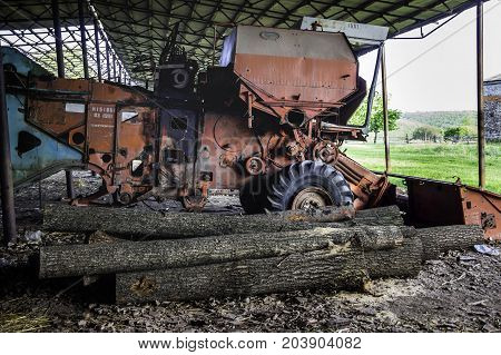 Old rusty abandoned spoiled combine harvester yenisej made in USSR