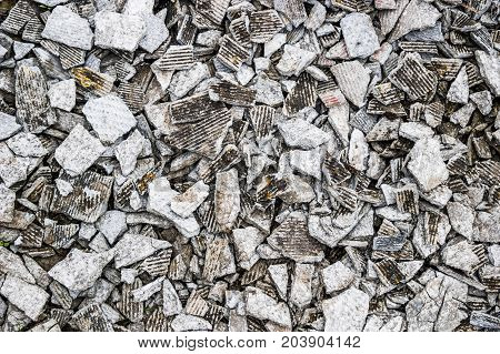 textured background of small tiles of broken slate