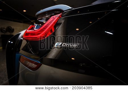 BERLIN - NOVEMBER 28 2014: Showroom. The rear lights of the car BMW i8 first introduced as the BMW Concept Vision Efficient Dynamics is a plug-in hybrid sports car developed by BMW.