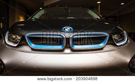 BERLIN - NOVEMBER 28 2014: Showroom. The BMW i3 previously Mega City Vehicle (MCV) is a five-door urban electric car developed by the German manufacturer BMW.