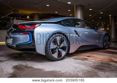 BERLIN - NOVEMBER 28 2014: Showroom. The BMW i8 first introduced as the BMW Concept Vision Efficient Dynamics is a plug-in hybrid sports car developed by BMW. Rear view.
