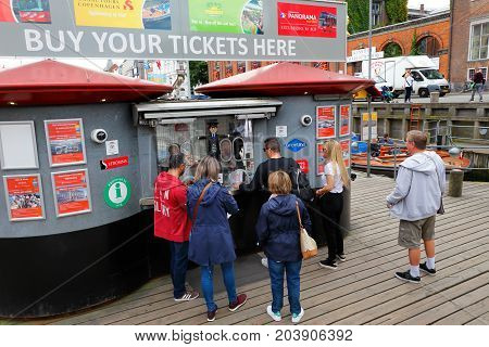 Copenhagen Denmark - August 24 2017: People buying tickets at the ticket booth for the sightseeing tours boat tours in Nyhavn operated by Stromma