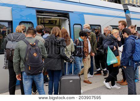 Sundbyberg Sweden - September 8 2017: Commuter train in service Greater Stockholm public transportation at Sundbyberg station exchanges passengers.