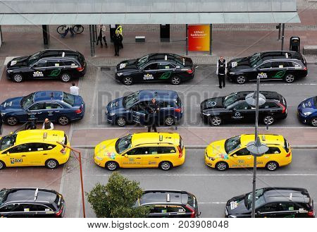Stockholm Sweden - September 8 2017: Taxis in service for several taxi companies are parked in rows at taxi rank outside Stockholm Central Station.