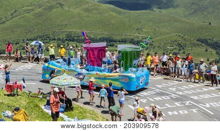 Col de PeyresourdeFrance- July 23 2014: Teisseire vehicle during the passing of the Publicity Caravan on the road to Col de Peyresourde in Pyrenees Mountains in the stage 17 of Le Tour de France on 23 July 2014.