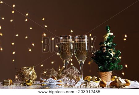 glasses of wine/ glasses of wine on the background of Christmas decorations. Christmas decorations with wineglass
