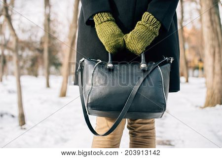 Cropped Image Of A Woman In A Coat Holding Her Purse