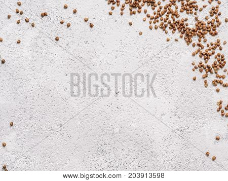 Brown Flax Seed On Gray Concrete Background.