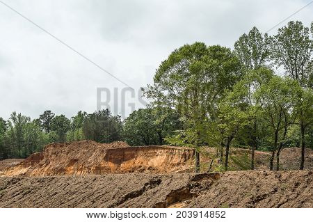 The Hill Country in Northeast Mississippi is a rich source of red clay dirt used in road building and for building up land at construction sites.