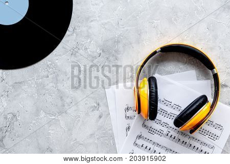 Desk of musician for songwriter work set with vynil record and notes on stone background top view mockup