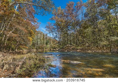 A tributary in the appalachian foothills of northeast Mississippi in early fall.