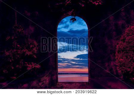 Collage of two photos. In the doorway of the stone wall we see a river sky cumulus clouds during the dawn. On the foreground is a fantasy light