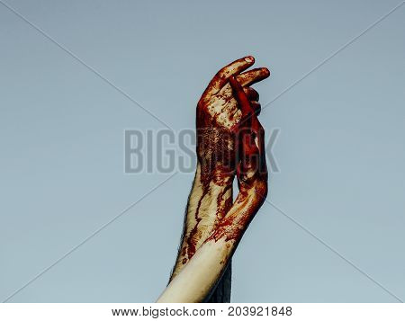 Halloween Bloody Hands Holding On Grey Sky Background
