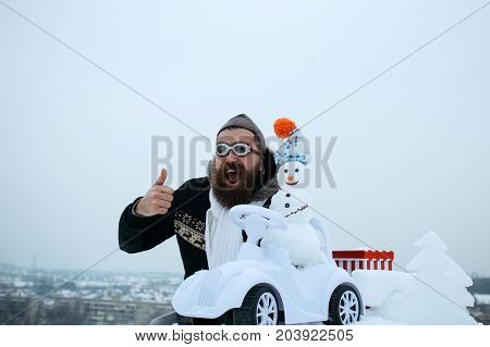 Bearded Man In Pilot Hat And Glasses Showing Thumbs Up