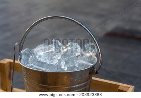 Ice in bucket. For soaking or mixing drinks.