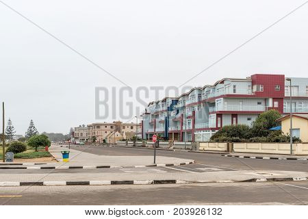 SWAKOPMUND NAMIBIA - JUNE 30 2017: A street scene with beach facing holiday apartments in Swakopmund in the Namib Desert of Namibia