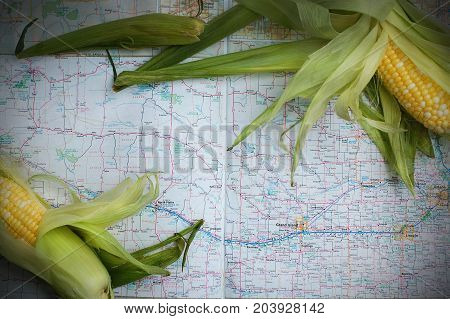 Corn husks pictured with a map of Nebraska.