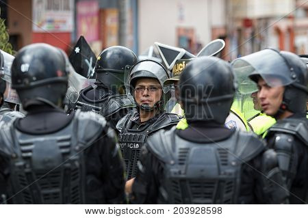 June 24 2017 Cotacachi Ecuador: riot police sorting out an altercation during the Inti Raymi parade