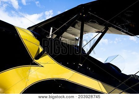 Closeup of a Vintage Open Cockpit Black and Yellow Airplane