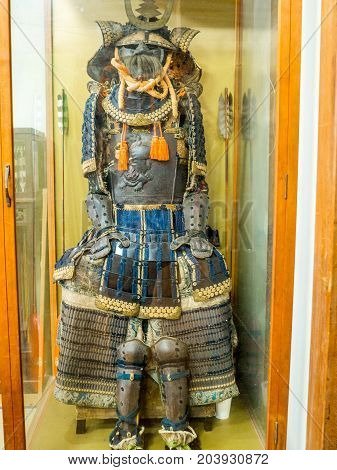 KYOTO, JAPAN - JULY 05, 2017: Close up of a soldier suit with helmet, shield, and protection, inside of a temple in the city of Kyoto, Japan.