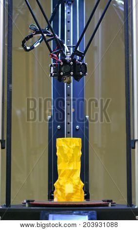 model vase inside 3d printer bottom view close-up. Progressive modern additive technologies 4.0 industrial revolution