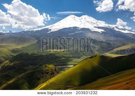 Elbrus And Green Hills At Sunny Summer Day. Elbrus Region North Caucasus Russia