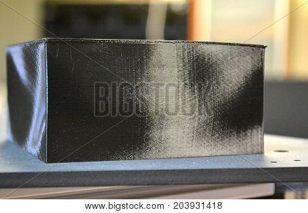 Black abstract printing object 3d printer close-up. Progressive modern additive technologies 4.0 industrial revolution