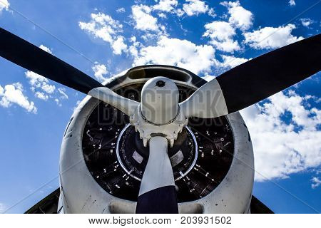 Black Propellor Against a Bright Blue Sky