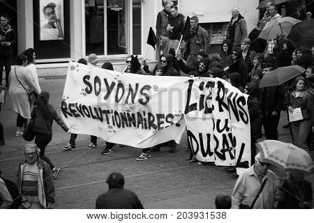 STRASBOURG FRANCE - SEPT 12 2017: Soyons Revolutionnaires translated as Be Revolutionary poster by incognito young people at French Nationwide day of protest against the labor reform proposed by Emmanuel Macron Government