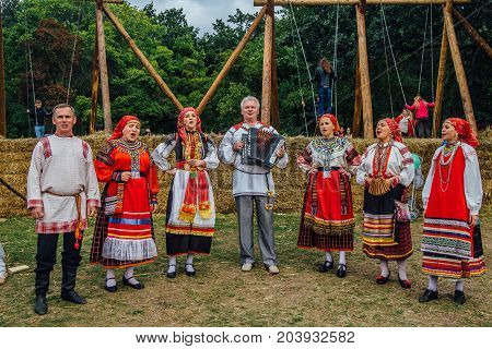 Voronezh, Russia - September 08, 2017: Traditional Russian folklore ensemble at the fair, accordionist and singers in traditional Russian ethnic suit for Voronezh Region