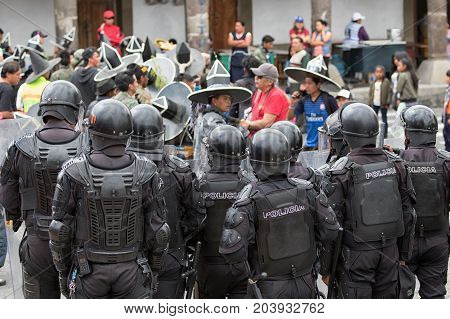 June 24 2017 Cotacachi Ecuador: riot police with shields standing on the side of the street during the Inti Raymi parade