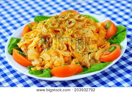 Pasta with cheese, decorated with organic vegetables