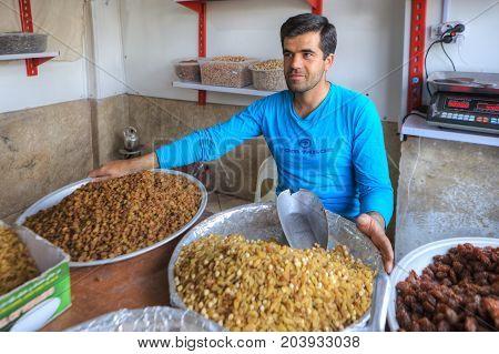 Fars Province Shiraz Iran - 18 april 2017: The Iranian sells dried fruits on the street market.