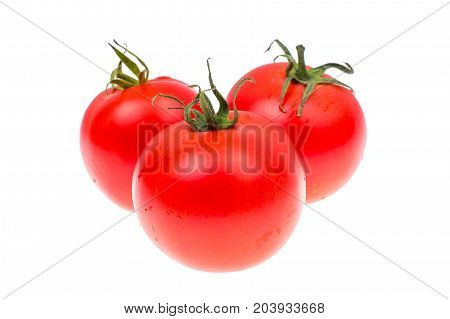 Several red ripe tomatoes isolated on white background. Studio Photo