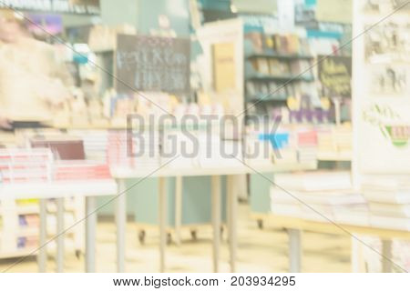 Light blurry backdrop of abstract books, textbooks or fiction in rows lying on tables, onshelves in library, urban bookshop. Education, school, study, reading fiction concept