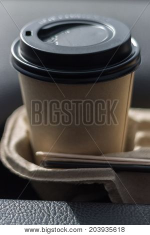 Coffee Take-away In A Paper Cup In The Car