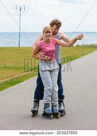 Roller Skater Couple Skating Outdoor