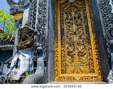 BALI, INDONESIA - MARCH 11, 2017: Golden door of the Uluwatu temple in Bali island, Indonesia.