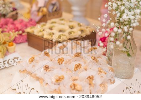 Horizontal picture of ornated table with bonbon with chestnuts for woman party