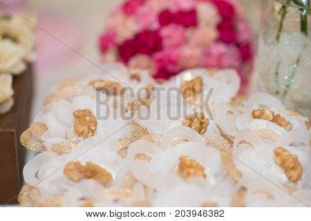 Macro picture of ornated table with bonbon with chestnuts for woman party