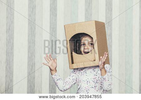 Child Little Girls Playing Astronaut In A Cardboard Helmet Portrait