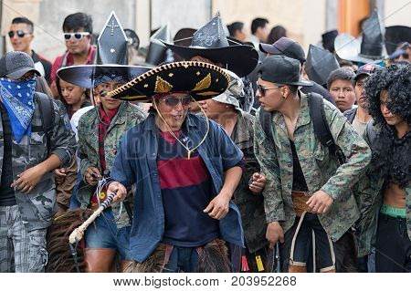 June 24 2017 Cotacachi Ecuador: closeup of an indigenous quechua man at the Inti Raymi parade wearing a large sombrero