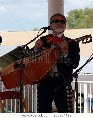 TAOS, NEW MEXICO - OCTOBER 1, 2011: Mexican musician performing on the street concert in Taos, New Mexico