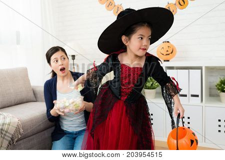 Child Grab Sweets Candy From Her Mother
