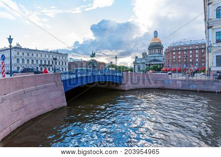 ST.PETERSBURG/ RUSSIA - JULY 19, 2017. The Blue Bridge near St. Isaac's Square with the Monument to Nicholas 1 and St. Isaac's Cathedral is one of the popular places for visiting the city's guests
